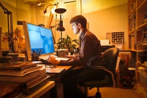 man-at-laptop-yellow-light